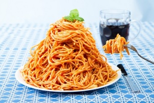 Huge Pile Of Spaghetti On Plate and Twirled Around Fork